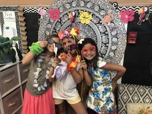 girls wearing luau attire