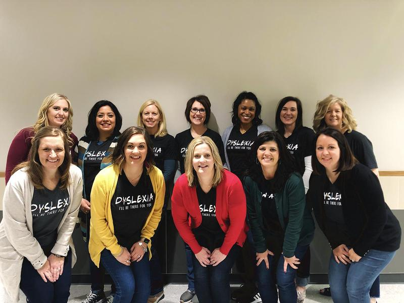 12 ladies of the dyslexia team pose in matching shirts