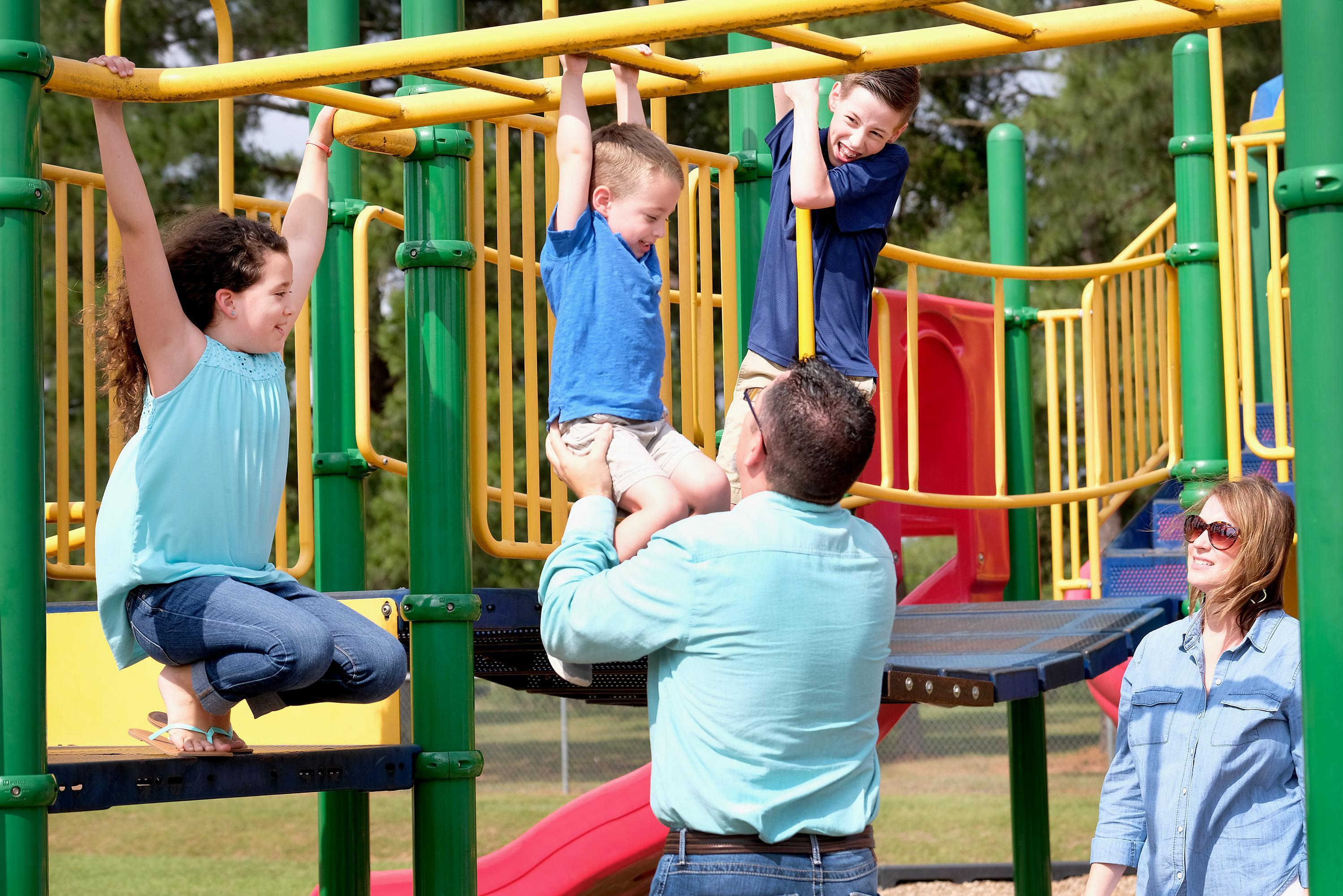 Family playing on a playground at Rosehill Elementary
