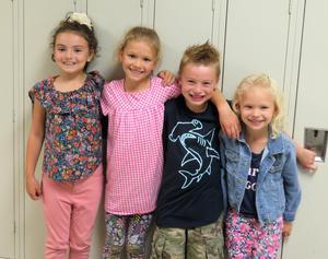 Layli Carpenter, Maggie McKeown,  Shaddik Carpenter, and Clara McKeown stand together at Lee Elementary.