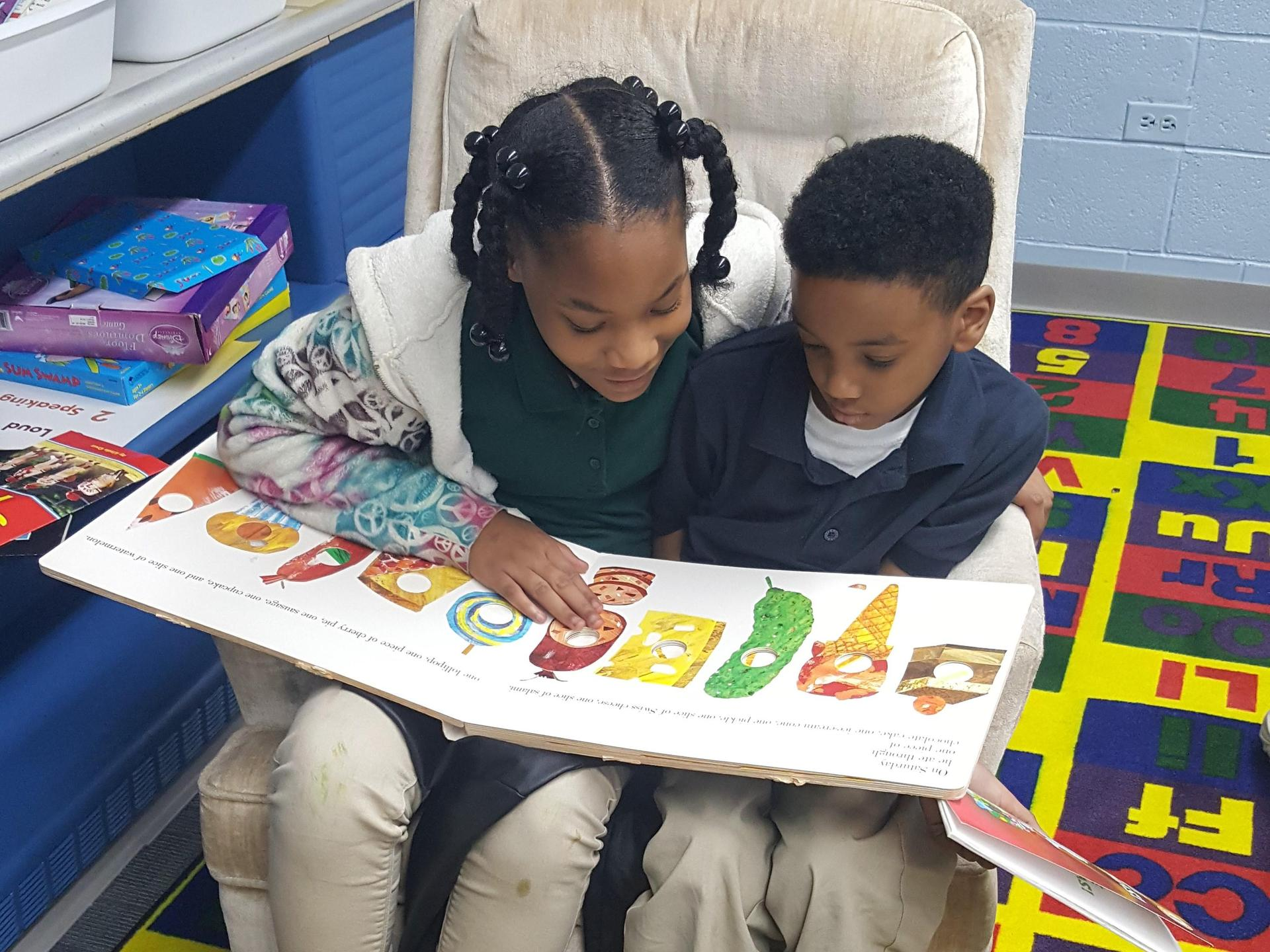 Student helps student with reading
