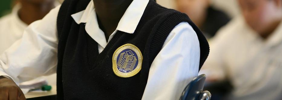 TYWLS student with school patch