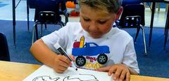 Kindergarten boy drawing