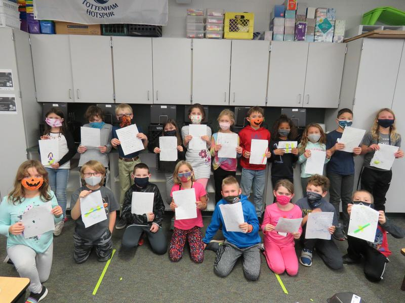 Mr. Sleeman's third-grade class writes letters to pen pals in Texas.