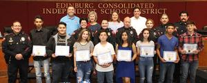 "Students from the Edinburg CISD First Time Offender Program pictured with (top row L-R) ECISD Superintendent Dr. René Gutiérrez, ECISD Board Member Dominga ""Minga"" Vela, ECISD Board Member Leticia ""Letty"" Garcia, Hidalgo County District Attorney Ricardo Rodriguez Jr. and officers from the ECISD Police Department."