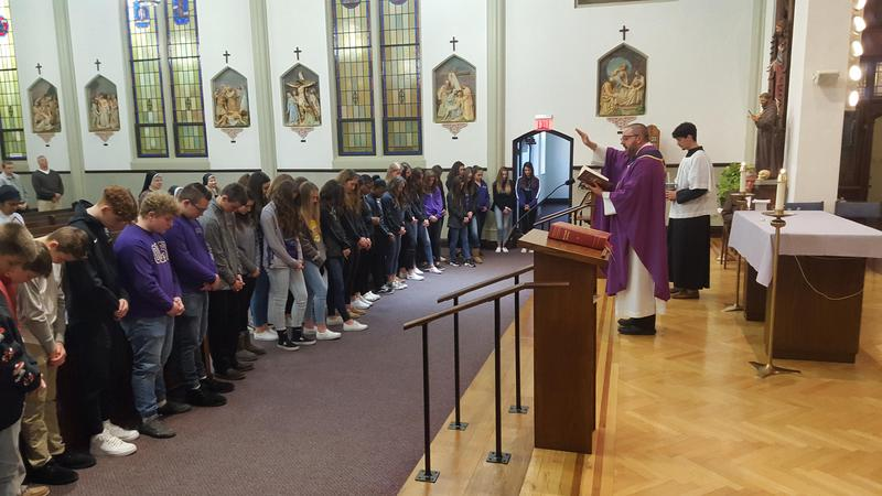 photo of students lined up in front of the altar