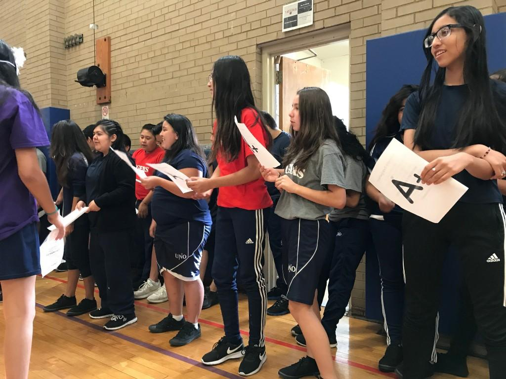 8th grade students sing their cheer