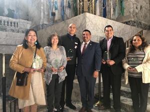 Nelly Mclauchlan receiving the 2019 Latino Legislative Award