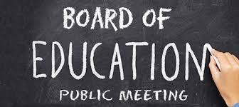 Board of Education Meeting on chalkboard.