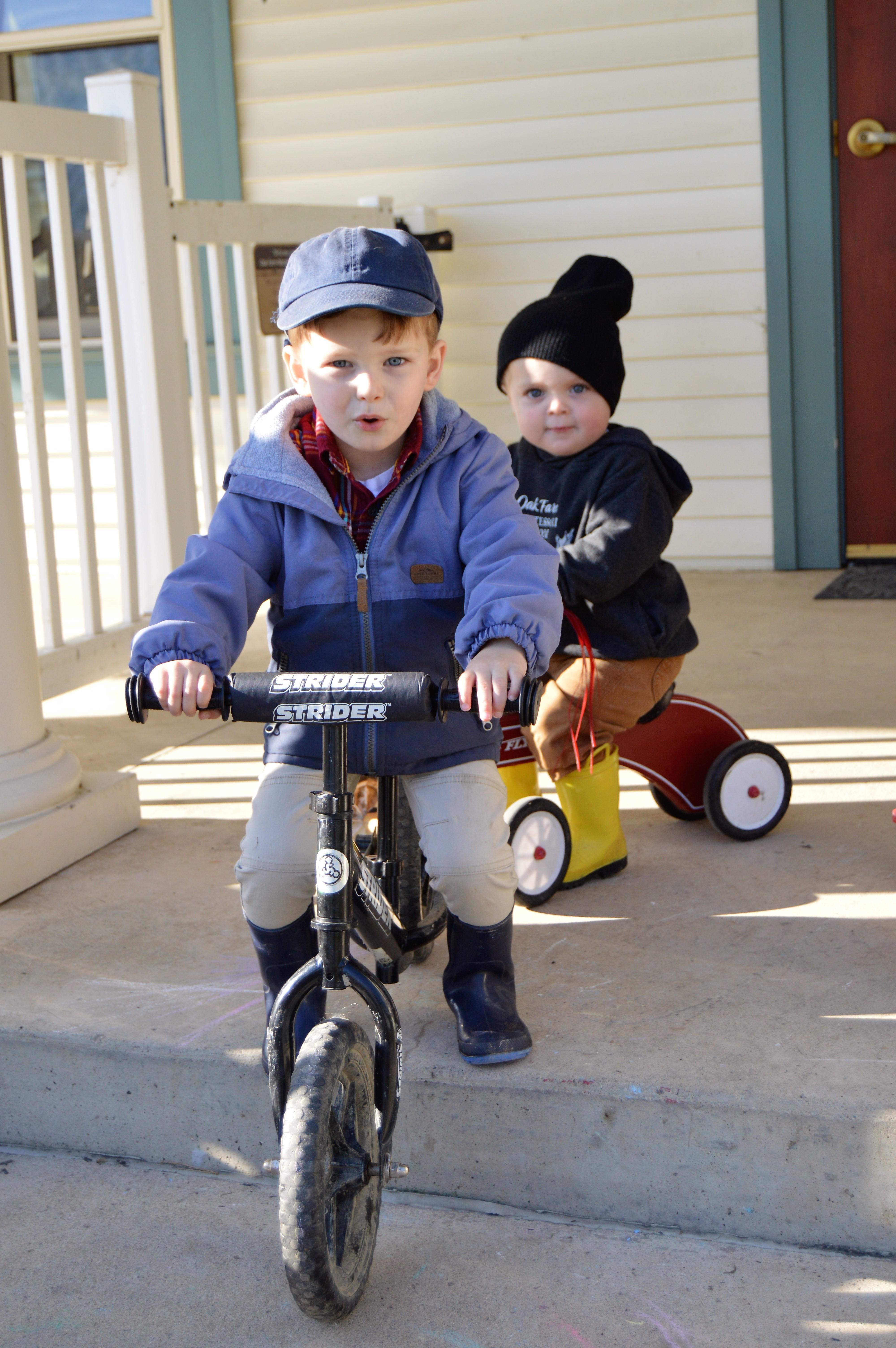 Toddlers riding bikes
