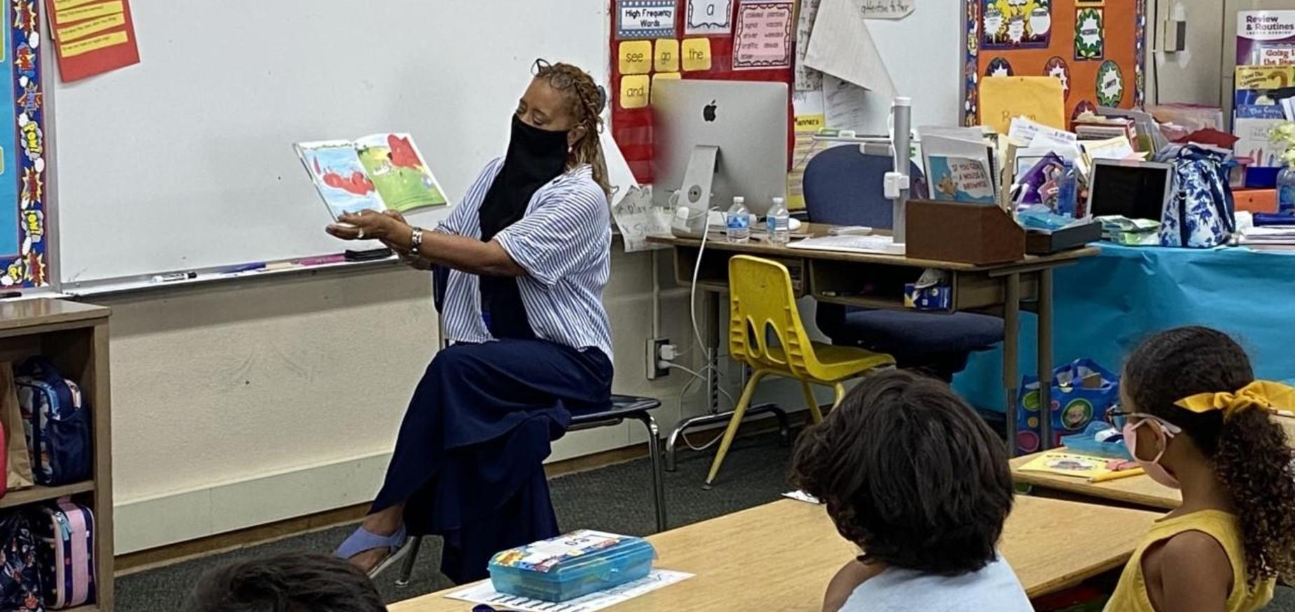 Librarian reading to students