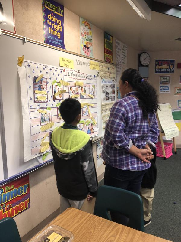 student showing their work to a parent, image 1