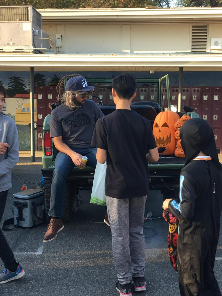 boy to back of pickup truck to get candy