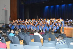 Members of the Bensalem High School Select Choir perform No Time and Let the River Run
