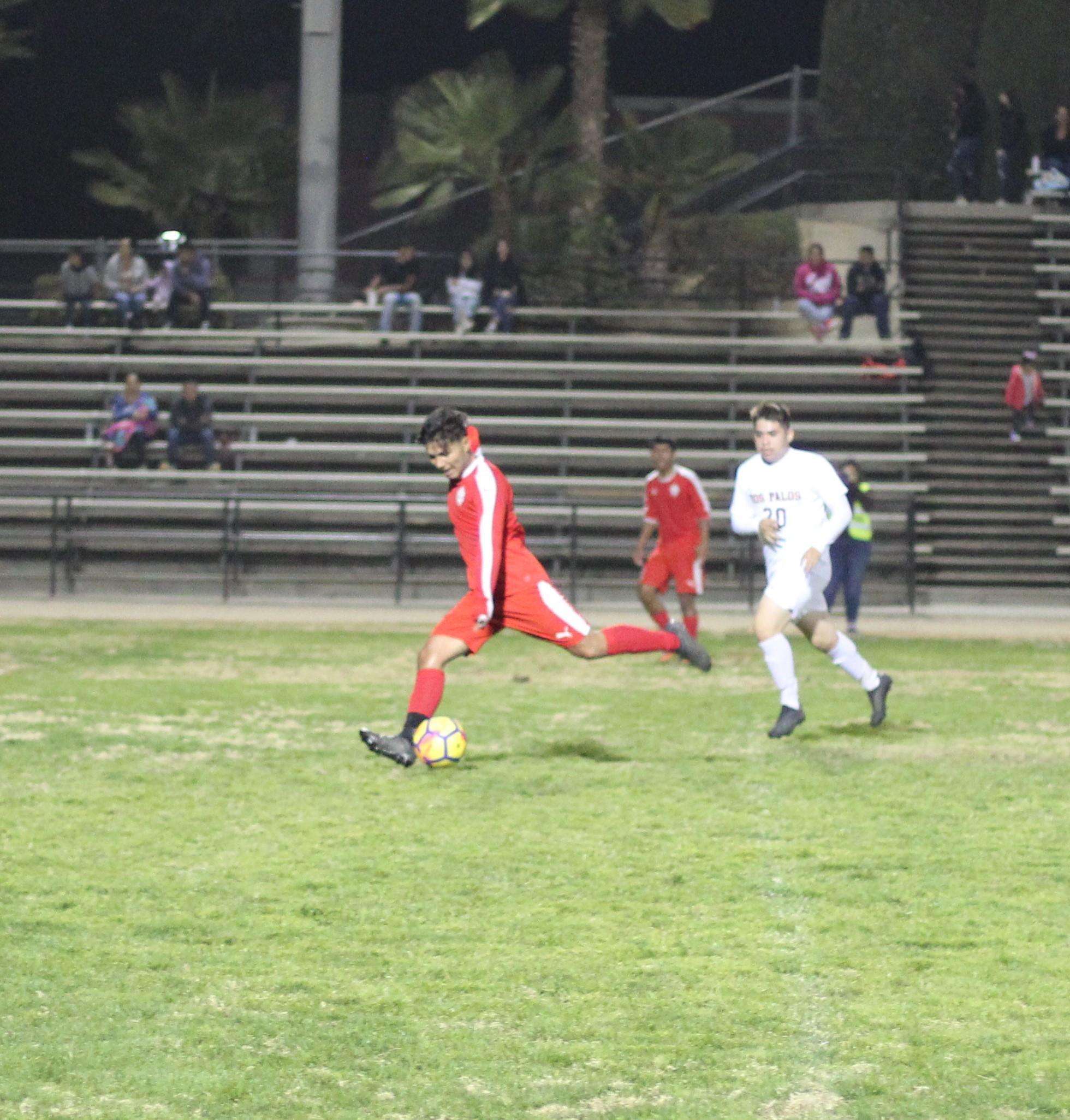 Favian Casillas running with the ball