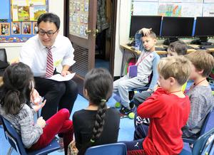 Photo of parent volunteer teaching Franklin 2nd graders basic phrases in Mandarin during the school's