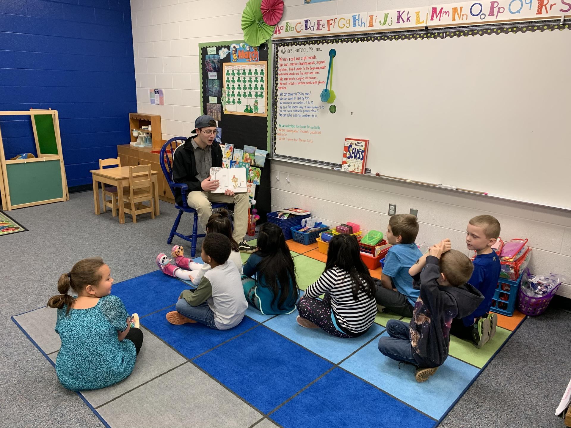 K students listening to our NJROTC reader