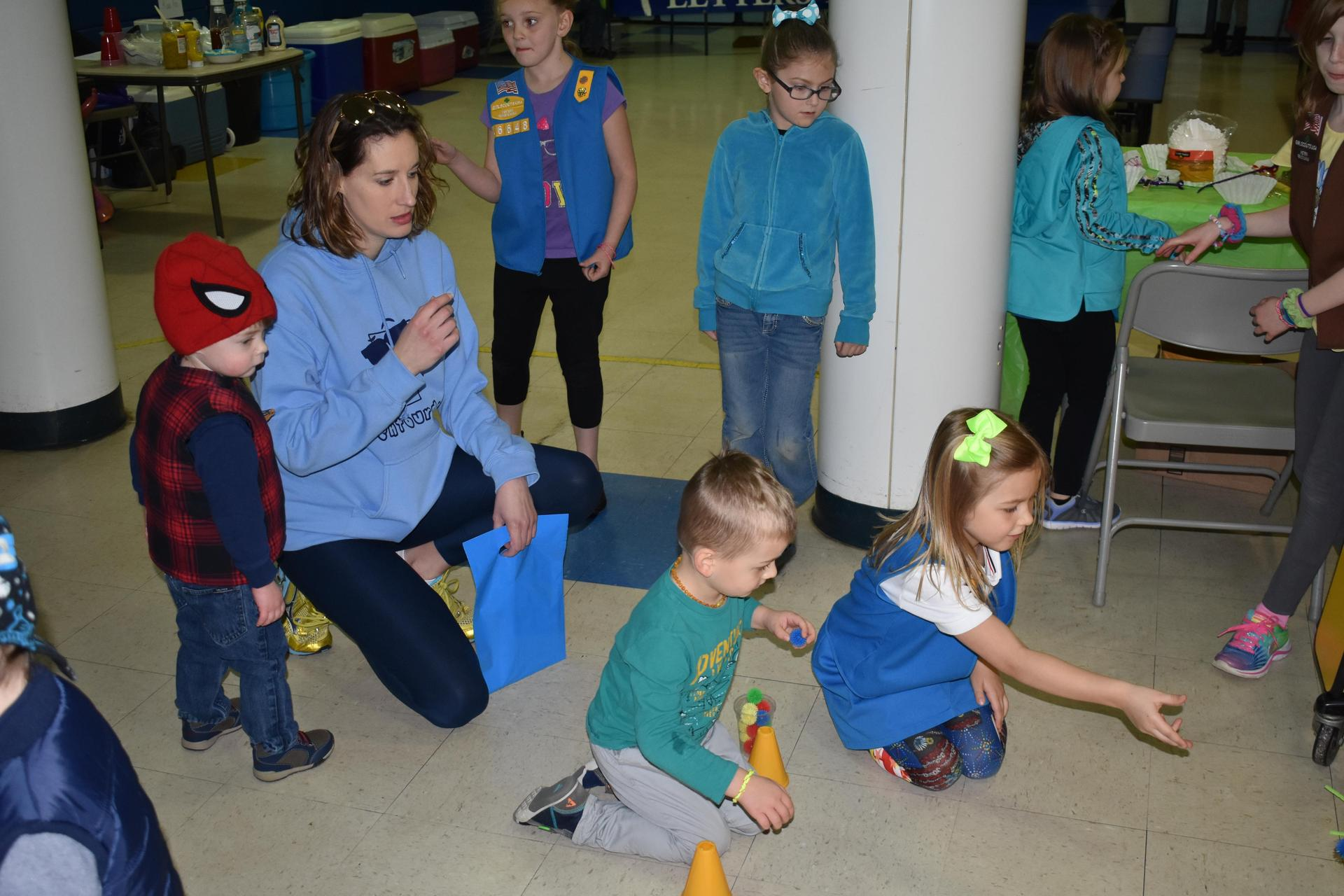 Mrs. Herncane helping kids with games