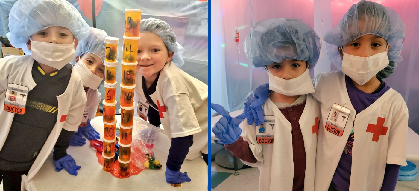 5 students learning while dressed up like doctors