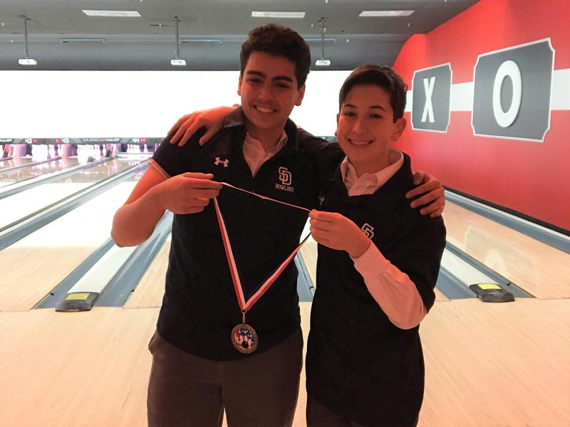 Bowling Team members win doubles match Featured Photo