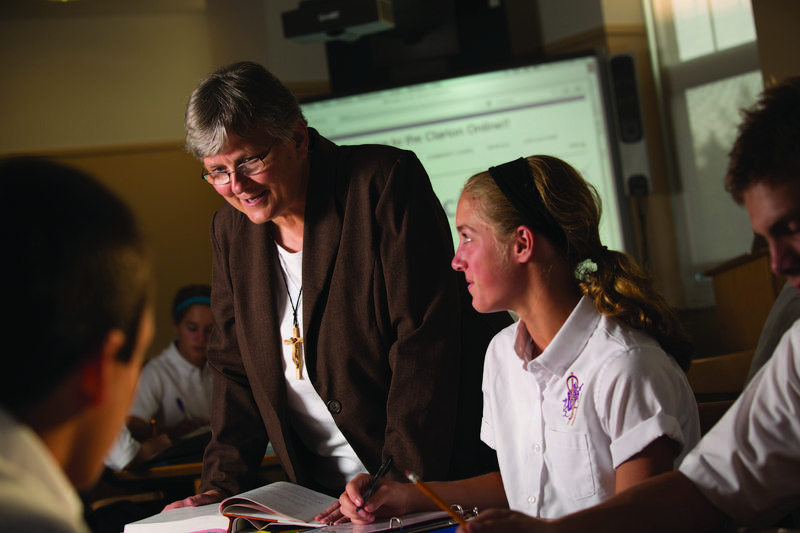 photo of Sr. Francine teaching students at a table