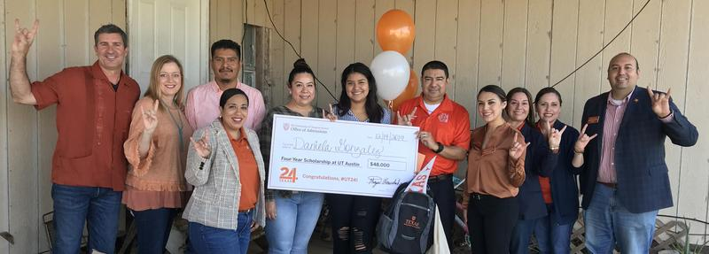 Economedes High School senior Daniela Gonzalez is pictured (center) alongside her parents, counselors and principal after being surprised at her northeastern Hidalgo County home by UT officials and alumni with a University of Texas at Austin Impact Scholarship.