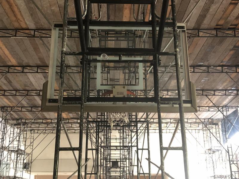 scaffolding by basketball hoop