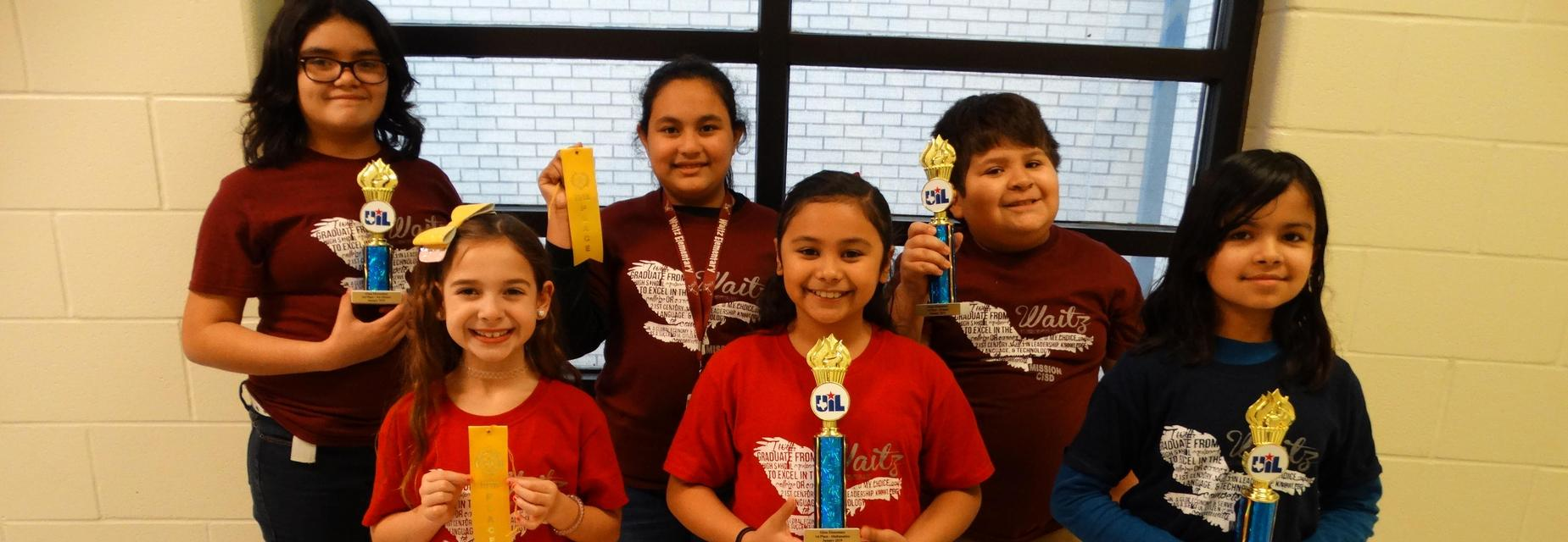 UIL kids pose with awards