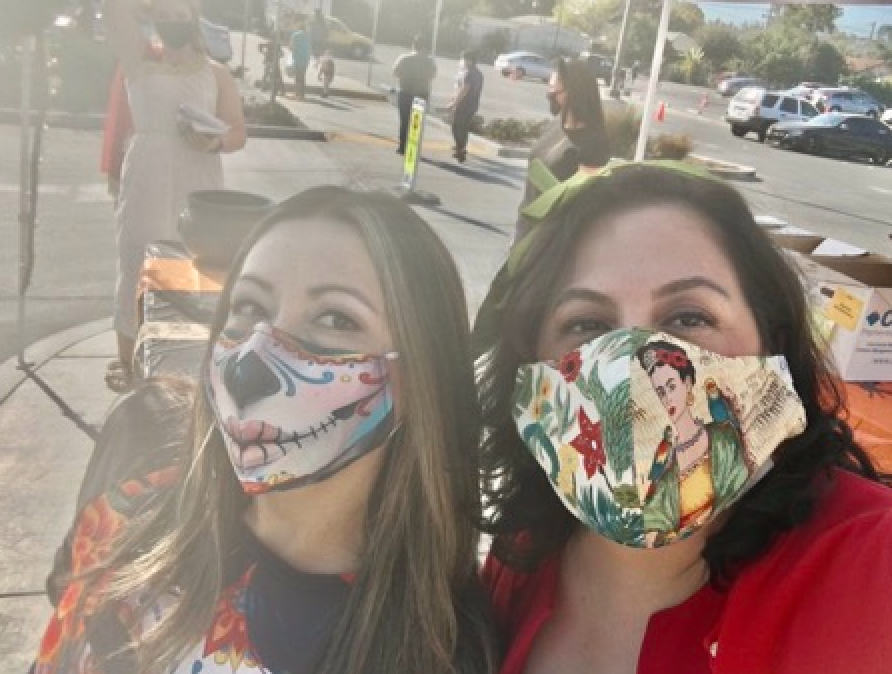 photo of principal reyes and council member maya esparza with masks at drive through event