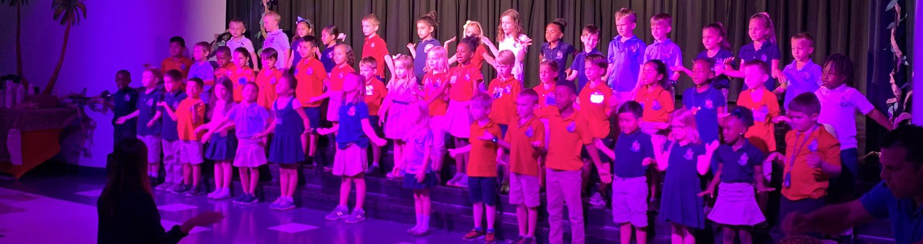 kids singing with purple light
