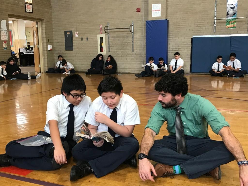 Mr. Elizondo reading with students