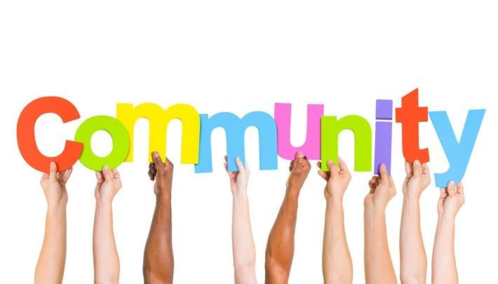 Many Arms holding up each letter of the word Community
