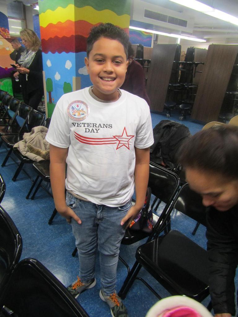 4th grade boy posing proudly