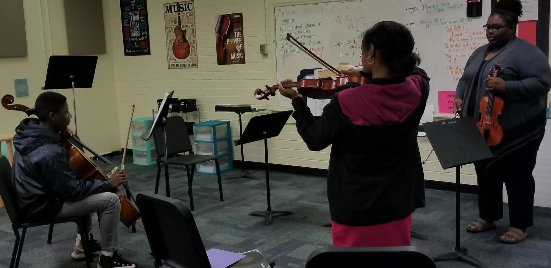 Orchestra Teacher and students practing
