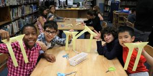 Origami butterflies at McKinley with students asked to write down a simple act they might perform to make a difference if given the chance. Organized by librarian Stacey Derector and school counselor Marybeth Herits, this activity is based on the book