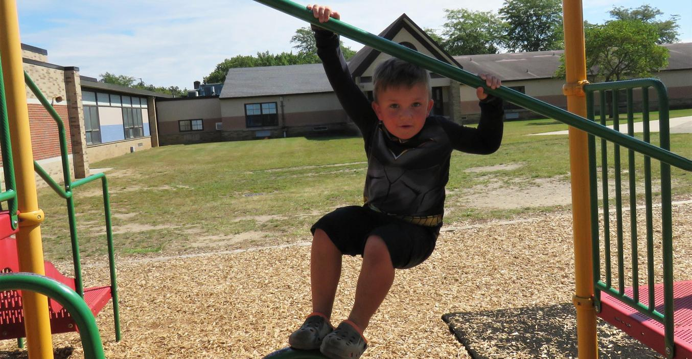 McFall student practices climbing and balance on the playground.