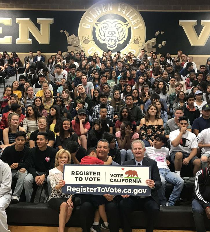 Secretary of State Alex Padilla is flanked by Hart District Superintendent Vicki Engbrecht and Governing Board Member Bob Jensen at Golden Valley High School