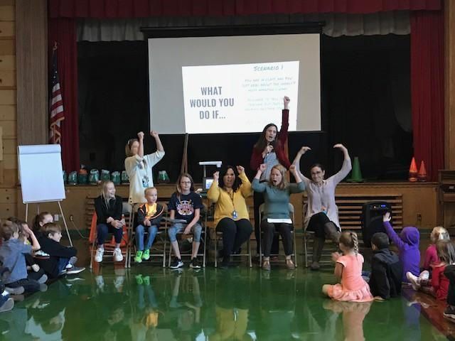 Students and techers participate in a game focused on making good behavioral choices.  All participants are engaged and having fun with the competition in the gym!