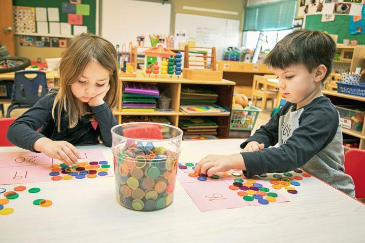 Preschoolers at HudsonWay Immersion School use manipulatives in a math lesson