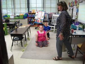Students and parents take part in math talks in the classroom.
