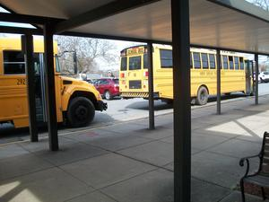 Buses ready to deliver meals to students.
