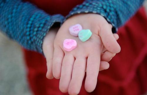 valentine candies in a child's hand.