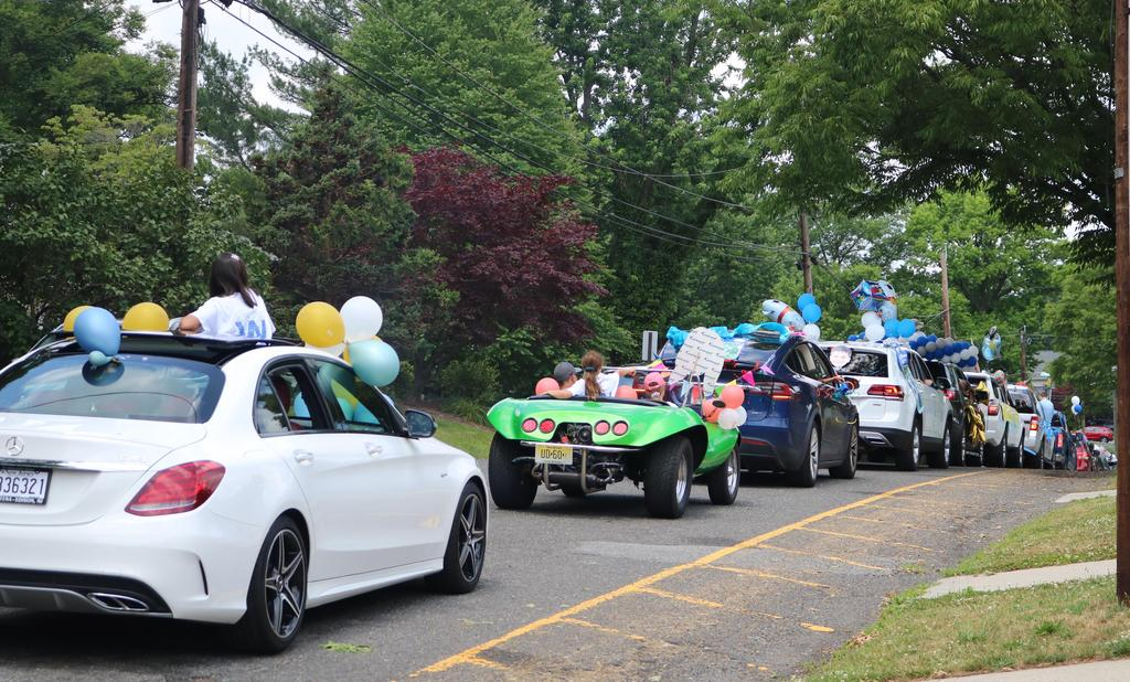 Photo of cars lined up for Wilson Grade 5 Clap Out Car Parade