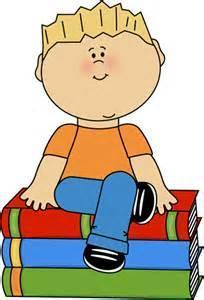 kid sitting on book