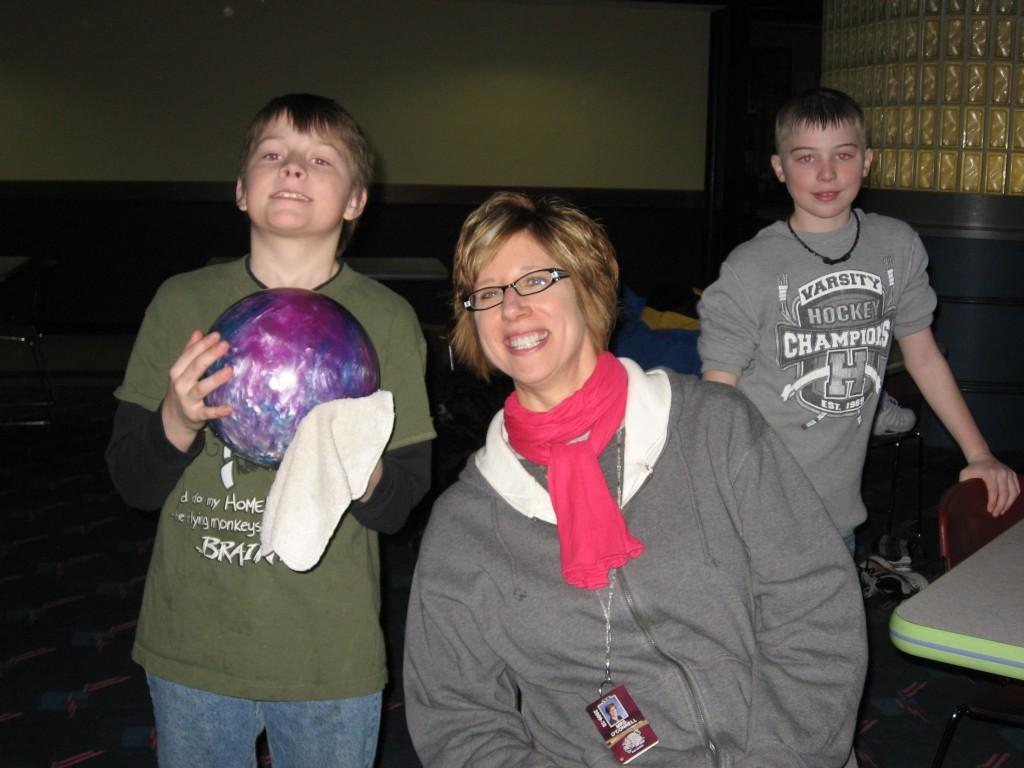 two boys and chaperone bowling