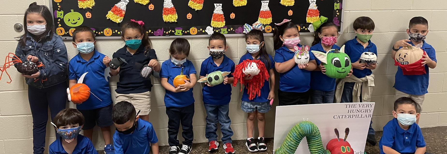 PreK students with pumpkin characters