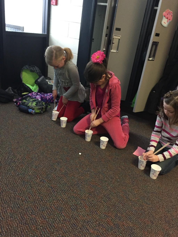 kids making Valentine crafts