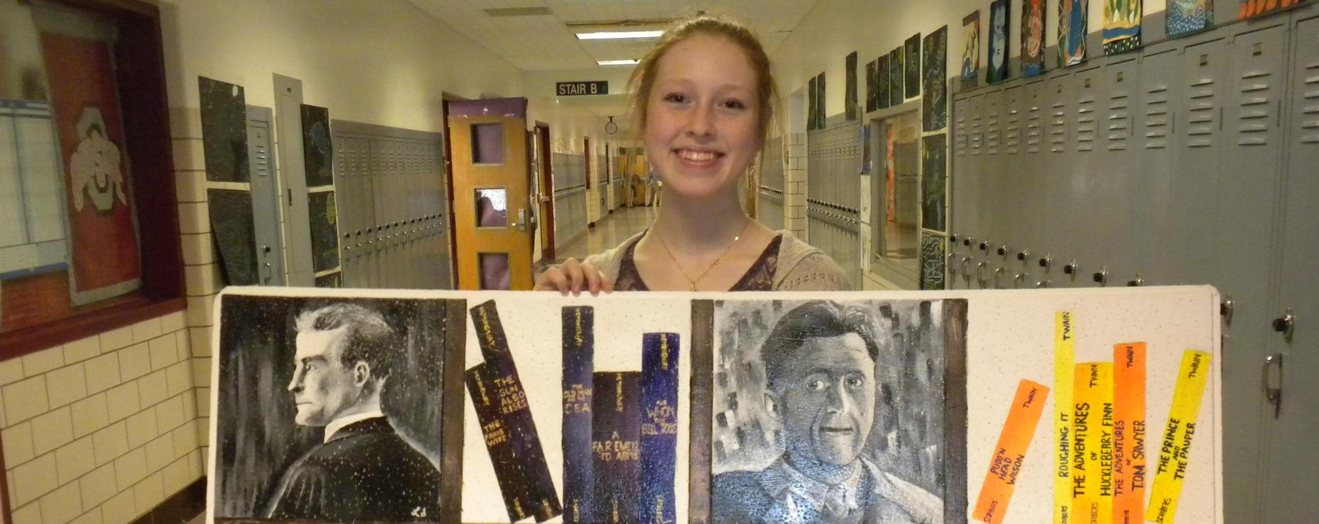 Valley High art student displaying her artwork.