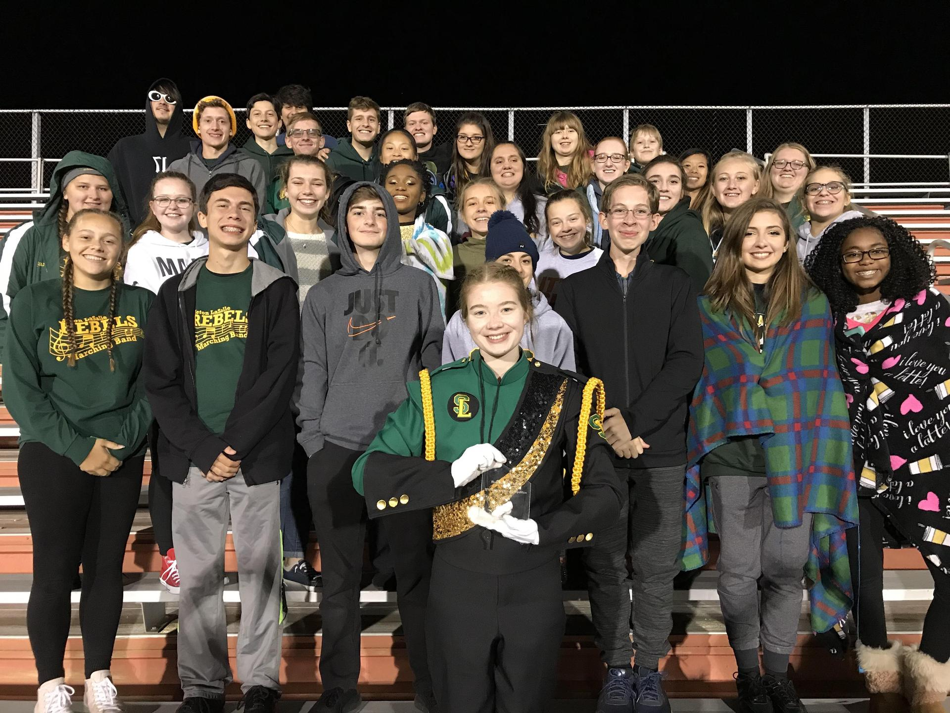 Marching Band poses with first place award