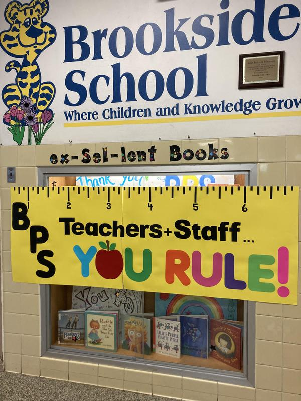 Sign that reads BPS Teachers Rule with a ruler